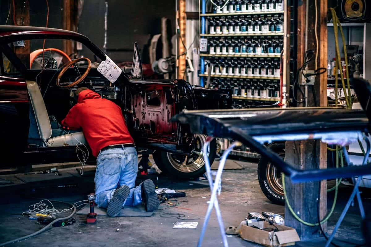 Person working on a car