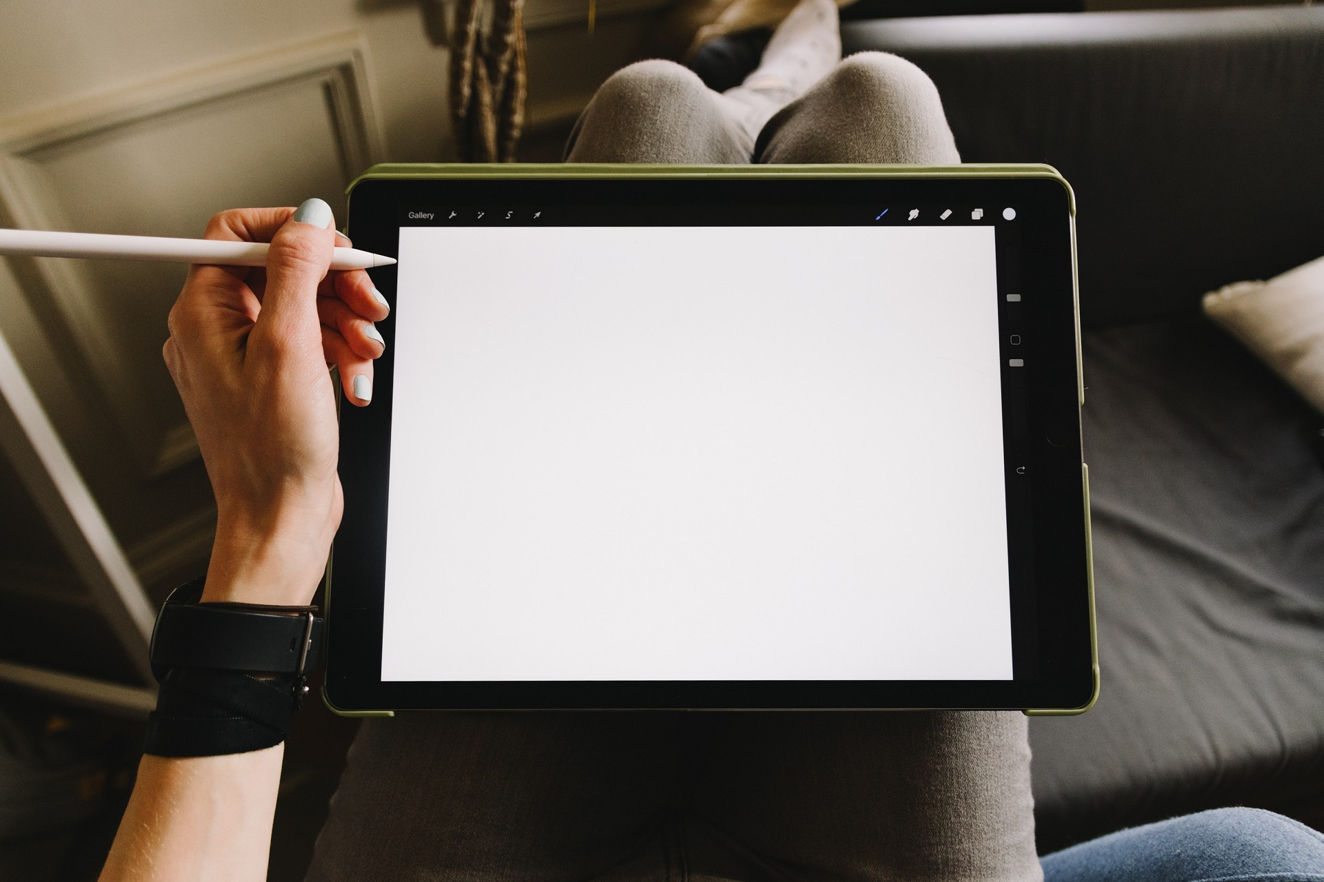 person holding apple pencil and ipad